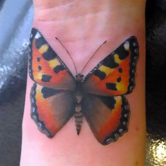 Simple Butterfly on Wrist Tattoo Idea