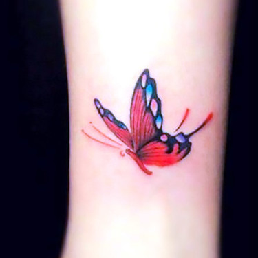 Tiny Girly Butterfly Tattoo