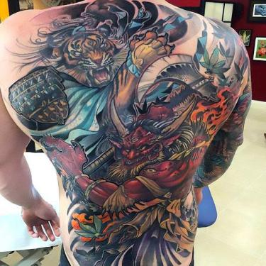Asian Tiger and Devil on Back Tattoo