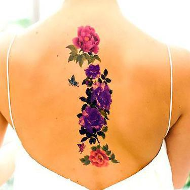 Best Flowers on Spine Tattoo