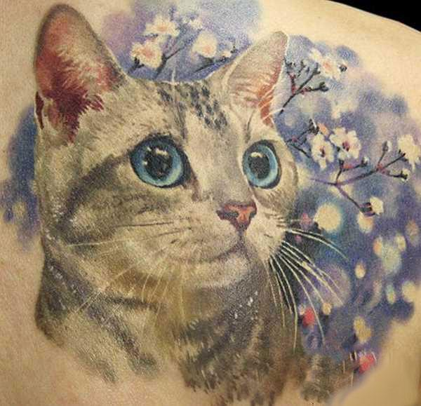 Cute Cat in Flowers Tattoo Idea