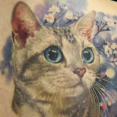 Cute Cat in Flowers Tattoo