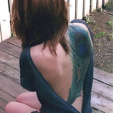 Big Peacock Feather on Back Tattoo