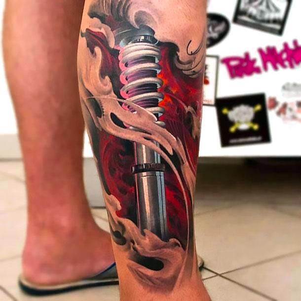Biomechanical Lower Leg Tattoo Idea
