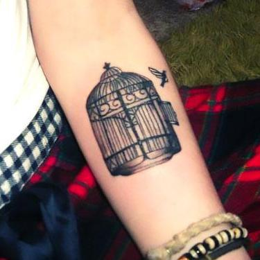 Birdcage on Forearm Tattoo