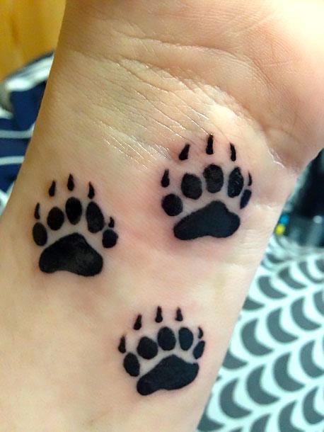 Bear Paw Prints Tattoo Idea