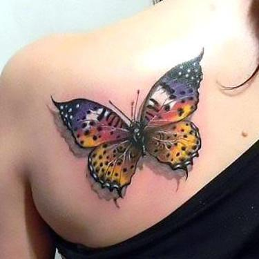 Beautiful Butterfly on Back Tattoo