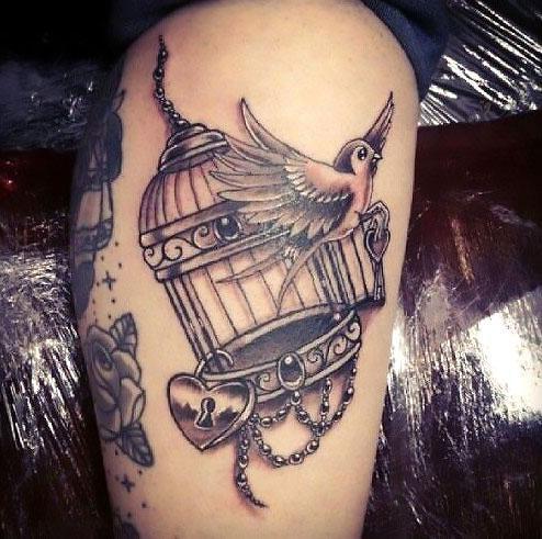 Locked Bird Is Free Tattoo Idea